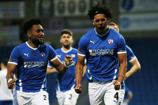 Josef Yarney celebrates with teammates after he scores Chesterfield's third goal against King's Lynn Town.