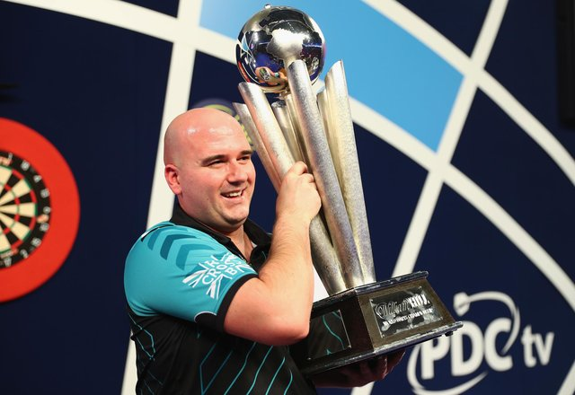 Rob Cross won £400,000 after winning the 2018 PDC World Darts Championships to complete a stunning transformation from 12 months ago. (Photo by Naomi Baker/Getty Images)