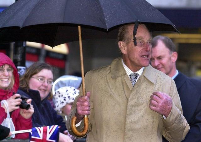 The Duke of Edinburgh braving the rain in Chesterfield in 2003.