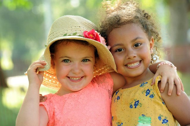 Chesterfield sunny pic. Luisa Bonsell, left, and Maya Mohammed enjoy the summer sun in Queens Park.