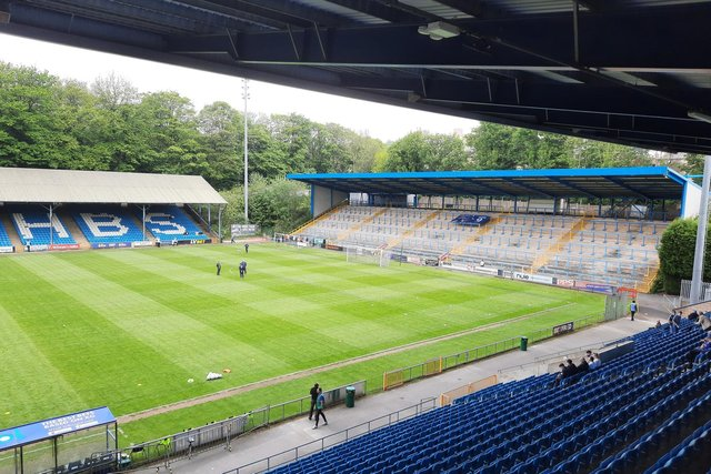 Chesterfield secured their place in the play-offs with a 2-1 win at Halifax.
