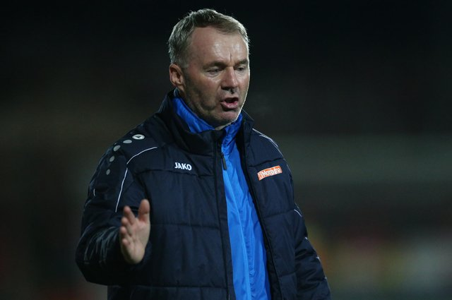 Former Chesterfield manager John Sheridan has resigned from his job at Swindon Town.