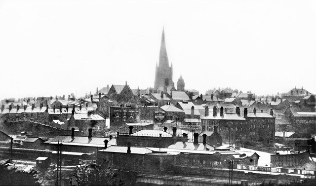 An early postcard shows Chesterfield railway station and the town's famous Crooked Spire church beyond.