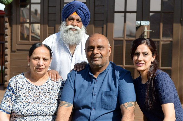 Post Office worker Harjinder Butoy (middle) was wrongly accused of stealing thousands of pounds but his conviction has now been overturned. He is pictured with his mum Satya Devi, dad Kesar Singh and wife Balbinder Butoy. Picture by Brian Eyre.