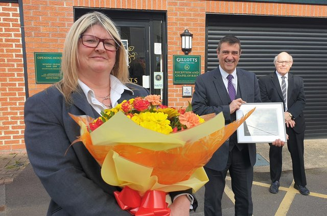 Helen Ellis celebrates her 25th year working for Gillotts Funeral Directors in Heanor, along with partners Anthony Topley and Barry Hutsby.