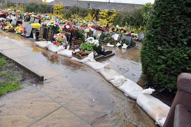 Amber Valley Borough Council says it is 'sorry for any distress caused by standing water in the cemetery'. Pictures taken by Brian Eyre in January.