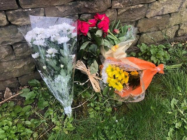 Flowers left on Malvern Road in Chesterfield after the tragedy.