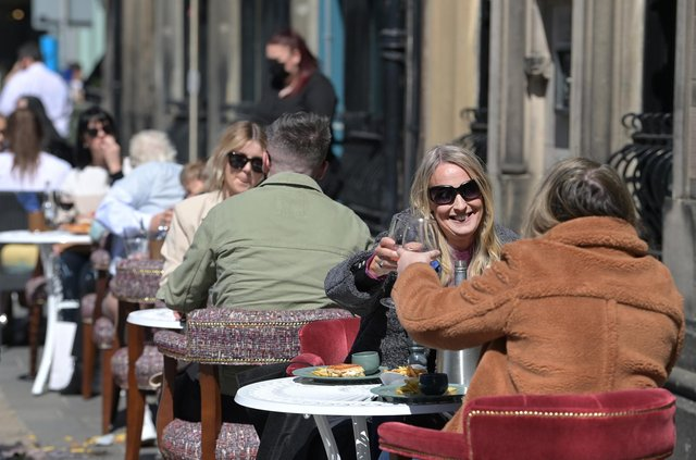 People raising their glasses as pubs with outdoor facilities reopened on April 30, 2021. Photo by Charles McQuillan/Getty Images.