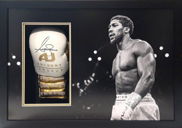 A boxing glove signed by Anthony Joshua is one of the lots.