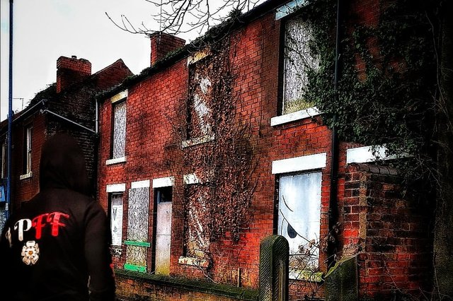Urban explorer Lost Places & Forgotten Faces outside the boarded-up and derelict properties on Chatsworth Road, near The Tap House pub.
