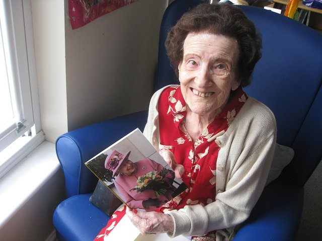 Joan Bullock with her card from the Queen at Ashgate House Care Home.
