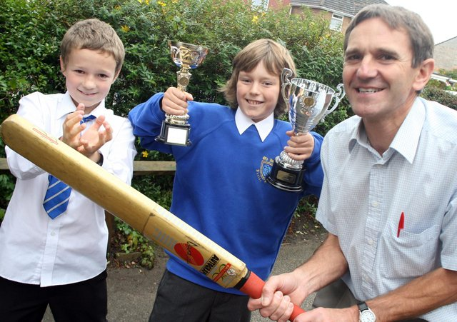 Old Hall teacher received a cricket award from Mike Gatting in 2008,  Steve Lawrence with pupils Christopher Thompson (left) and Jordan Reynolds.