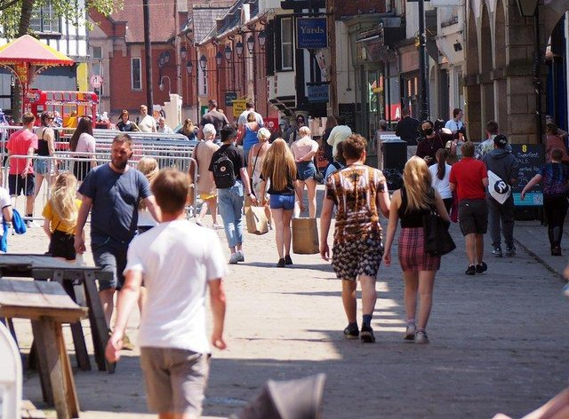 Shoppers enjoy the warm weather in Chesterfield town centre.