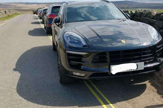 Derbyshire police posted this picture of cars parked on double-yellow lines at Curbar Edge, Derbyshire.