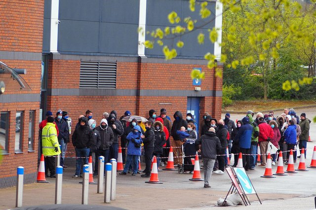 Spireites fans queueing for tickets for the last home match of the season against Dagenham and Rebridge.