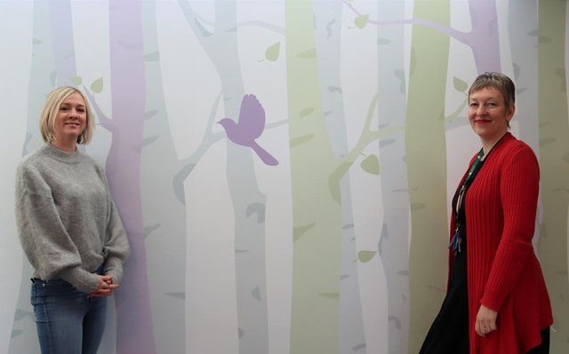 Artist Emma Duerden with the new designs in the wellbeing space at Treetops Hospice.