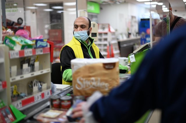 A recent union report has documented an increase in shopworkers being abused during the pandemic. (Photo by DANIEL LEAL-OLIVAS / AFP) (Photo by DANIEL LEAL-OLIVAS/AFP via Getty Images)
