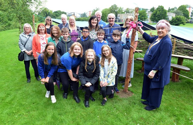 Stonelow Junior School opens forest school area. The seats and canopy has been funded partly by PTA fundraising and partly by Dronfield rotary club donation. Liz Blanshard president of Dronfield Rotary opens the new area.