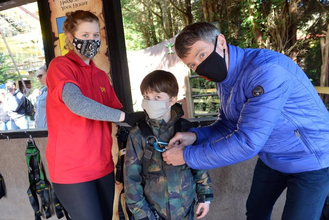 Beth Davies helps Anthony and Jules Vyrne put their safety harness on before going on the new ride Riggers Revenge at Gullivers Kingdom.