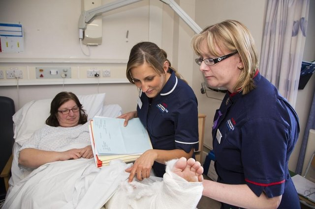 Nurses at Chesterfield Royal Hospital checking on the progress of a recovering patient in 2016.