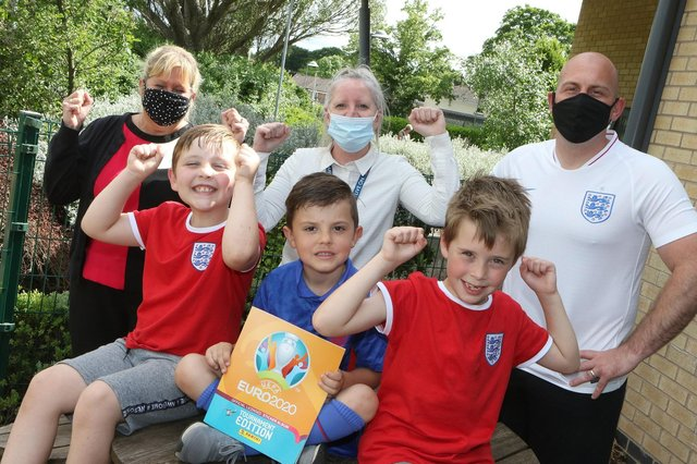 Hollingwood Primary School year two pupils Declan, Kaiden and Harris with one of the sticker books. Also pictured are Tracy Spizer and Karen Hennell, from Morrison's, and deputy headteacher Ian Holmes.