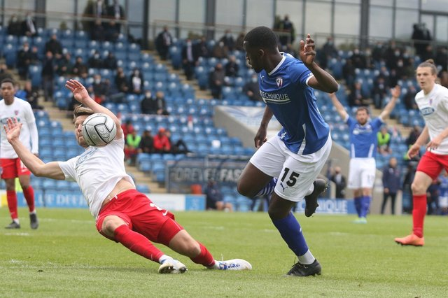 Chesterfield beat Dagenham and Redbridge 2-1 at the Technique Stadium to keep their play-off hopes alive.