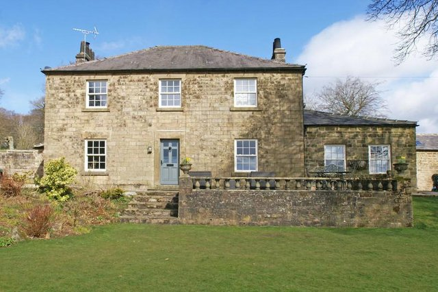 """The property is described as a """"refurbished and extended substantial country house""""."""