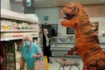 Samuel Hutchison donned a dinosaur costume to take his grandmother Mary shopping