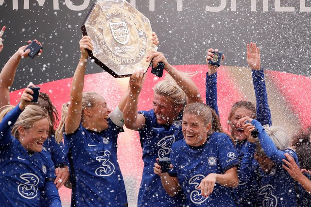 Magdalena Erkisson and Millie Bright of Chelsea lift the Community Shield Trophy following her team's victory on August 29, 2020 in London, England.
