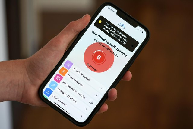 """The NHS Covid-19 app alerts the user """"You need to self-isolate"""". Photo illustration by Christopher Furlong/Getty Images."""