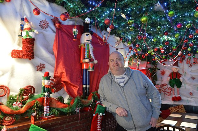 Mark Thomas, Landlord of The Hanging Gate in Chapel-en-le-Frith with the Christmas decorations the pub has kept up ahead of reopening on May 17.