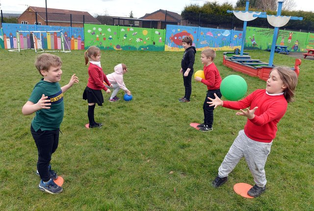 Year 2 pupils taking part in PE at  Henry Bradley Infant School