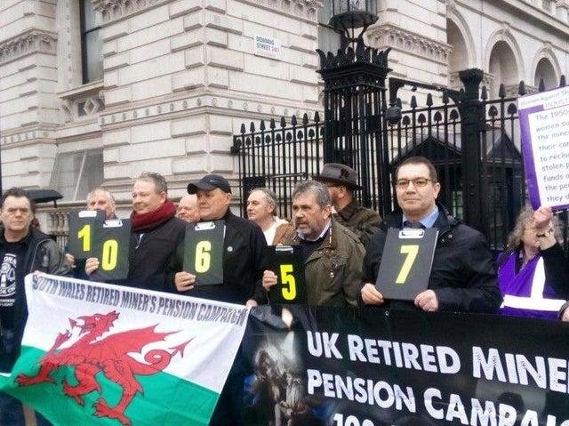 Former mineworkers campaigning outside Downing Street for a fairer pensions deal