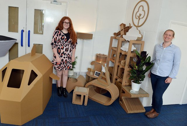 Designers Lizzy Barker and Katie Galley pictured with their cardboard creations.