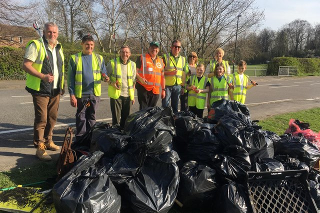 Simon Parker (centre - in orange) on a litter pick with Hollingwood residents as part of the annual Great British Spring Clean event.