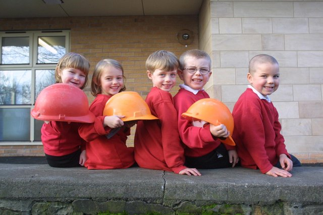 Local kids with hard hats.