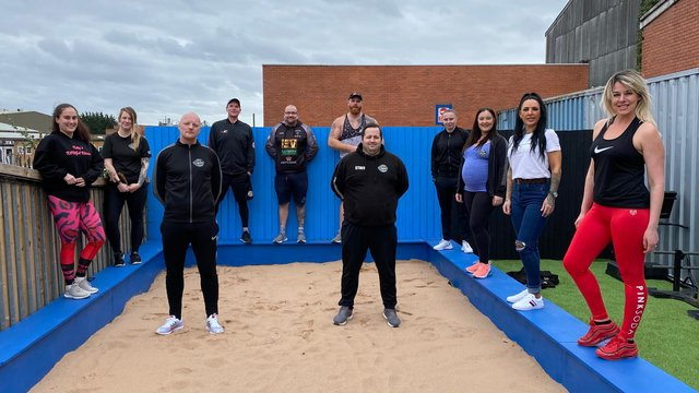 Paul Holmes, pictured centre left, and the team in the outdoor training space at Full Power Fitness in Heanor.