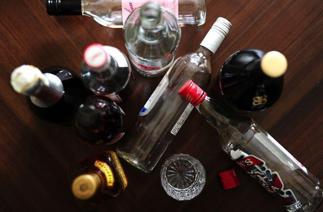 Party-goers greeted police with drinks and bottles of spirits in hand and tried to shut officers out of the property
