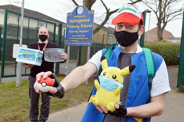 Hollingwood Primary School's new Pokemon-style game for children. Ian Holmes, deputy headteacher, and Guy Dopson, student teacher, with the game.