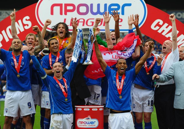Mark Allott and Dwayne Mattis of Chesterfield celebrate with the trophy after being crowned Champions during the npower League Two match between Chesterfield and Gillingham at the B2Net Stadium on May 7, 2011.