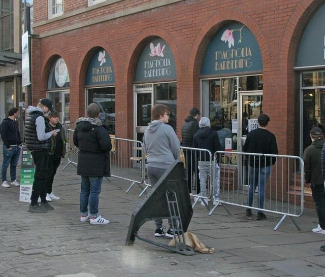 People queuing outside Magnolia Barbering in Chesterfield on Monday as they patiently waited for a post-lockdown haircut.