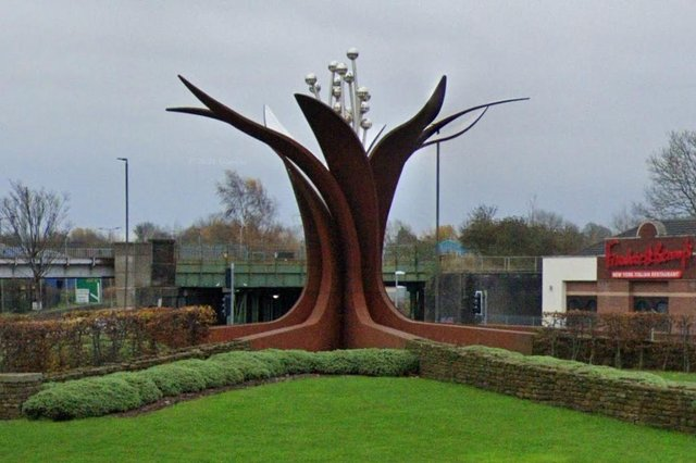 """Melanie Jackson's sculpture Growth, on Horns Bridge Roundabout, is featured on Chesterfield art Trail. It says: """"The sculpture signifies the confidence and continuous growth of the town. The wheel design in the ground represents the town's many industries, both past and present, and twists upwards at the centre to form an emerging flower."""""""