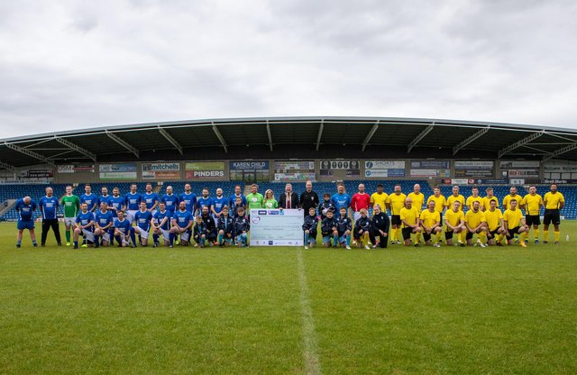 Teams line up for the charity match at Chesterfield FC. Photo: Tina Jenner.
