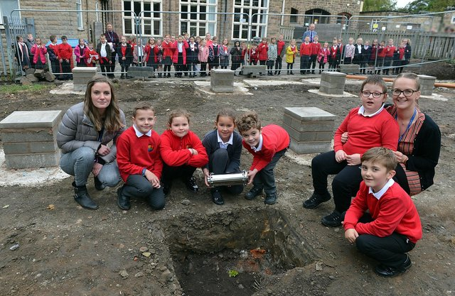 Highfield Hall Primary School pupils Harry, Susie, Elliott, Lily, Alex and Tommi-Lee with teachers Miss Sullivan and Mrs Webster during the planting of the time capsule. Pictures by Brian Eyre.