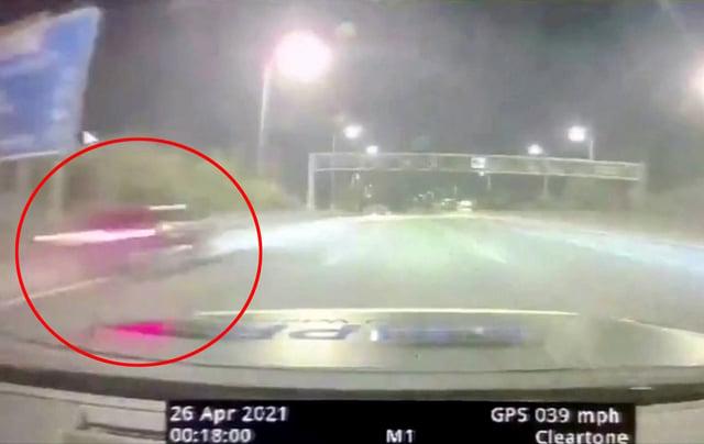The moment Usman Kiani's black Audi S3 flies past police