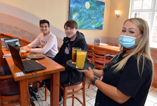 Customers enjoy drinks indoors at Chesterfield Spa Lane Vaults on the first day of reopening.