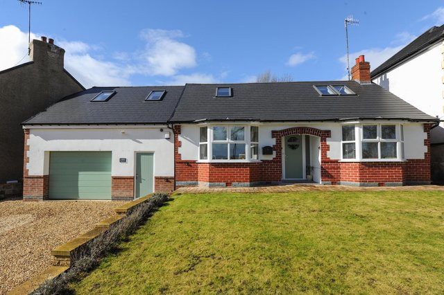 The detached bungalow has four bedrooms, two on the ground floor and two on the first floor.