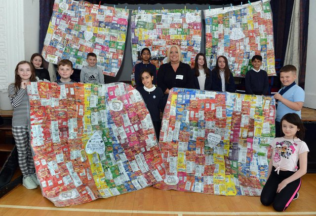 Chesterfield Spire Junior School crisp packet project. Members of the school council with Sarah Sammans, lead nurse at Pathways of Chesterfield.