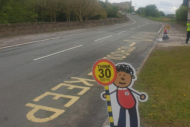 Signs urging motorists to obey the speed limit outside Penny Acres Primary School in Holmesfield