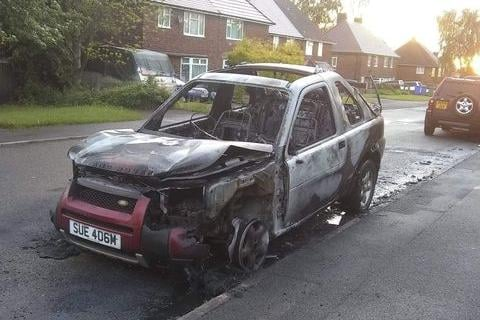The Land Rover Discovery after it was set alight in Newbold, Chesterfield.